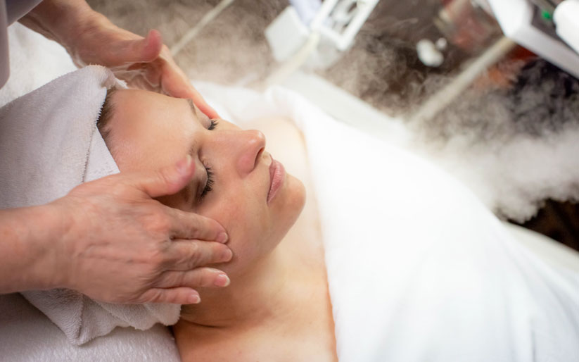 Woman Cleansing Facial